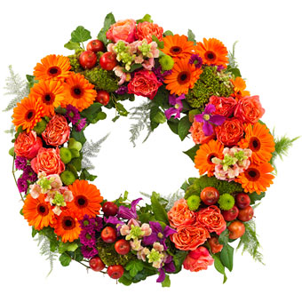 Funeral wreath in orange and purple colours.